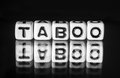 Taboo with black and white theme letters text Royalty Free Stock Images
