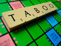 Taboo scrabble an editorial image of a board with the word great for creative news articles on topics or words Stock Photos
