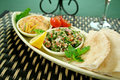 Tabouleh hommus lemon chick peas fresh pita bread Stock Photo