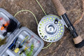 Tackle Box with flies and Fly Fishing Rod Royalty Free Stock Photo