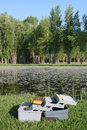 Tackle box by pond Stock Image