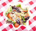 Taco salad on checkered tablecloth Stock Photo