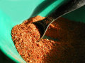 Taco seasoning homemade a in a teal colored bowl with a black measuring spoon and dramatic natural lighting Stock Photography