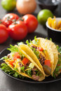 Taco shells with beef and vegetables Stock Images