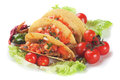 Taco shells filled with grilled chicken meat and fresh vegetable salad Stock Photo