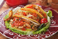 Taco shells filled with grilled chicken meat and fresh vegetable salad Stock Photos