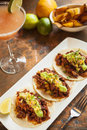 Tacos al pastor with a mango margarita Stock Images