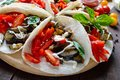Tacos is a traditional Mexican snack. Eggplants, sweet peppers, tomatoes in pita bread Royalty Free Stock Photo