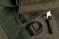 Tactical holdall army bag zipper handle and eyelet detail of a showing canvas Royalty Free Stock Photography