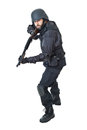 Tactical position a swat agent wearing a bulletproof vest and aiming with a gun Stock Photography
