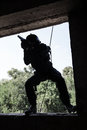 Tactical rappeling spec ops soldier in face mask during rope exercises with weapons Royalty Free Stock Photography