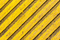 Tactile paving slab texture a tile of yellow color with raised diagonal lines Stock Photos