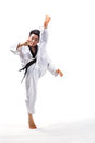 Taekwondo action by a young man Royalty Free Stock Photography