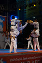 Taekwondo Double Kick Mid-Air Breaking Boards Stock Photos