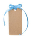 Tag label with blue ribbon bow isolated on white background Royalty Free Stock Image
