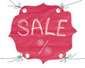 Tag made ​​of paper showing discounts on goods the word sale written by hand Stock Photography