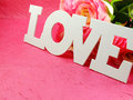 Tag with words with love and rose on pink background Royalty Free Stock Photo