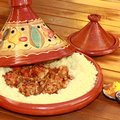 Tagine tajine beautiful terracotta with semolina and meatballs a spiced meal Stock Image