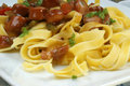Tagliatelle with organic sausage goulash Stock Photo