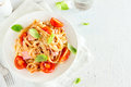 Tagliatelle pasta with ham and tomatoes Royalty Free Stock Photo
