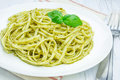 Tagliatelle pasta with pesto sauce Royalty Free Stock Photo