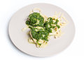 Tagliatelle with spinach on plate sauce and Royalty Free Stock Photo