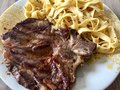 Tagliatelle with tail steak stripe and champignons Royalty Free Stock Photo