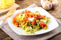 Tagliatelle with tomato mozzarella and bacon on complex background Stock Photos