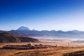 Tagong temple and laya snow mountain mountains at sunrise in kangding of sichuan province of china Royalty Free Stock Photos