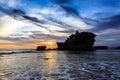 Tahah Lot Temple and ocean waves at sunset, Bali Royalty Free Stock Photo