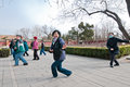 Tai chi training beijing china march th group of old chinese people practicing t ai ch uan commonly know as in jingshan park Stock Photos
