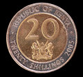Tail of a shilling coin issued by kenya in the head face the republic depicting the national emblem image isolated on black Stock Photography