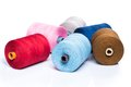 Tailoring colorful threads on white background many Royalty Free Stock Photos