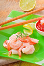 Tails of shrimps with fresh lemon and rosemary in a green plate Royalty Free Stock Images