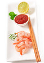 Tails of shrimps with fresh lemon and rosemary in a white bowl Stock Images