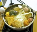 Taiwanese flavor of hot pot with meat ball corn and vegetables etc Royalty Free Stock Photography