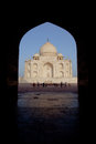Taj Mahal within archway Stock Photo