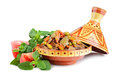 Tajine with meat moroccan national dish full of and vegetables marjoram and tomatoes on a white background Stock Photos