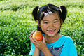 Take the apple of Asian girls Royalty Free Stock Images