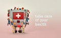 Take care of your health advertisement template poster. Medical first aid robotic monitor red display. Friendly toy Royalty Free Stock Photo