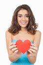 Take my love attractive young woman holding a red paper heart and smiling at camera while standing isolated on white background Royalty Free Stock Photo