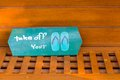 Take off youe shoes your wood sign on the wood shelf Royalty Free Stock Images