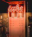 Take out neon sign on a steel column Stock Photos