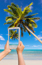 Take photo by tablet beauty beach Royalty Free Stock Photo