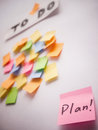 Take plan for the to do list single note written stands out from chaos sticky notes Stock Image