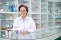 Take this prescription portrait of female pharmacist giving you Stock Photos