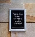 Take A Seat Restaurant Signage Royalty Free Stock Photo