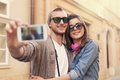 Take a selfie fashionable couple taking by mobile phone Royalty Free Stock Photos