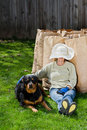 Taking a break woman and her dog after cleaning up the back yard Royalty Free Stock Photography
