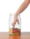 Taking candy child s hand reaching out to take from a jar Stock Images